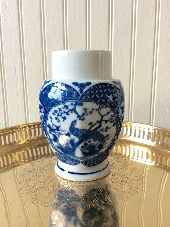 Beautiful blue & white porcelain candleholder ( tea light candleholder). Hexagon shape with peacock design on two sides. Sticker on bottom made in Japan. In very good vintage condition, no chips. Great for anyone who loves Chinoiserie decor, Asian decor, or collects blue & white! Wonderful size for mantle, table top, entryway or wall sconce shelf. Etched brass tray sold separately in shop!  Measures 5.5 height x 3.75 wide  Holds Candlesticks & Tea Lights  Thanks for shopping…