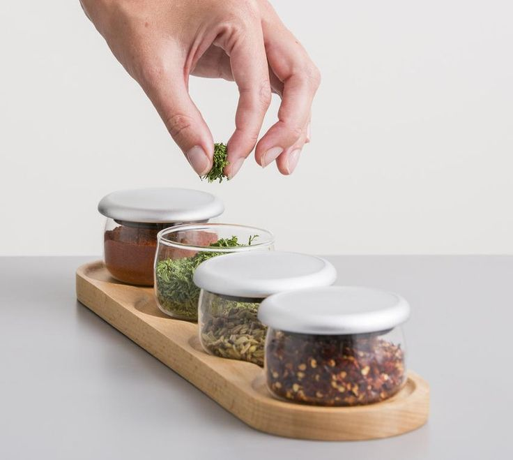 These jars are perfect for sprinkling a pinch of herbs and spice onto your food. 4 glass jars and rack. Ideal stash pots for herbs and spices. Big enough for a tablespoon. Capacity of each jar: 75ml. Push fit lids. Dishwasher safe.