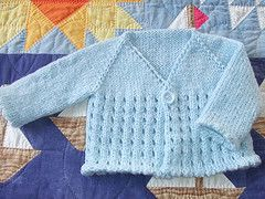 This is a really quick and easy seamless baby cardi, knitted from the top down. The eyelets in the pattern also work as buttonholes, making it easily adaptable for either boys or girls :-)