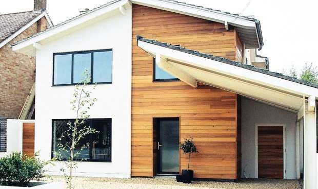 Adding render and cedar cladding to the exterior or this formerly plain 1960s house has transformed the property into a contemporary home. Shallow-pitched roofs complete the look.