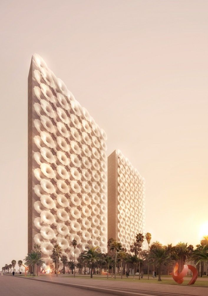 REX Designs Conjoined Media Towers with Retractable Facade for Middle East