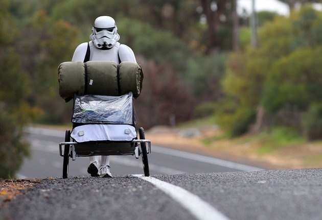 JACOB FRENCH, YOU ROCK!!!  :)  Perth, Australia - July 15: Stormtrooper Jacob French is pictured on day 5 of his over 4,000 kilometre journey from Perth to Sydney walking along Old Mandurah road approximately 20 kilometres from Mandurah on July 15, 2011 in Perth, Australia. French aims to walk 35-40 kilometres a day, 5 days a week, in full Stormtrooper costume until he reaches Sydney. French is walking to raise money for the Starlight Foundation - an organisation that aims to brighten the…
