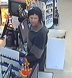 Detectives investigating the armed robbery of a Morayfield supermarket have released an image of a man who may have information about the crime. About 5.30pm on November 30, 2013, a man armed with a handgun entered a Glenmay Court supermarket and demanded cash from two female employees. He is described as about 185cms tall, with a slim build and was wearing a black jumper with a brown stripe, black trousers and had dark hair. If you can identify this man, call Crime Stoppers on 1800 333 000.