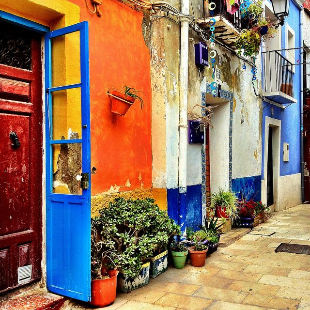 Typical narrow lanfe in Alicante, Spain, a town that overlooks the sea, with inviting ambiance.