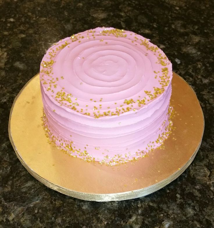 Pink smash cake with edible gold flakes and cupcakes                                                                                                                                                     More