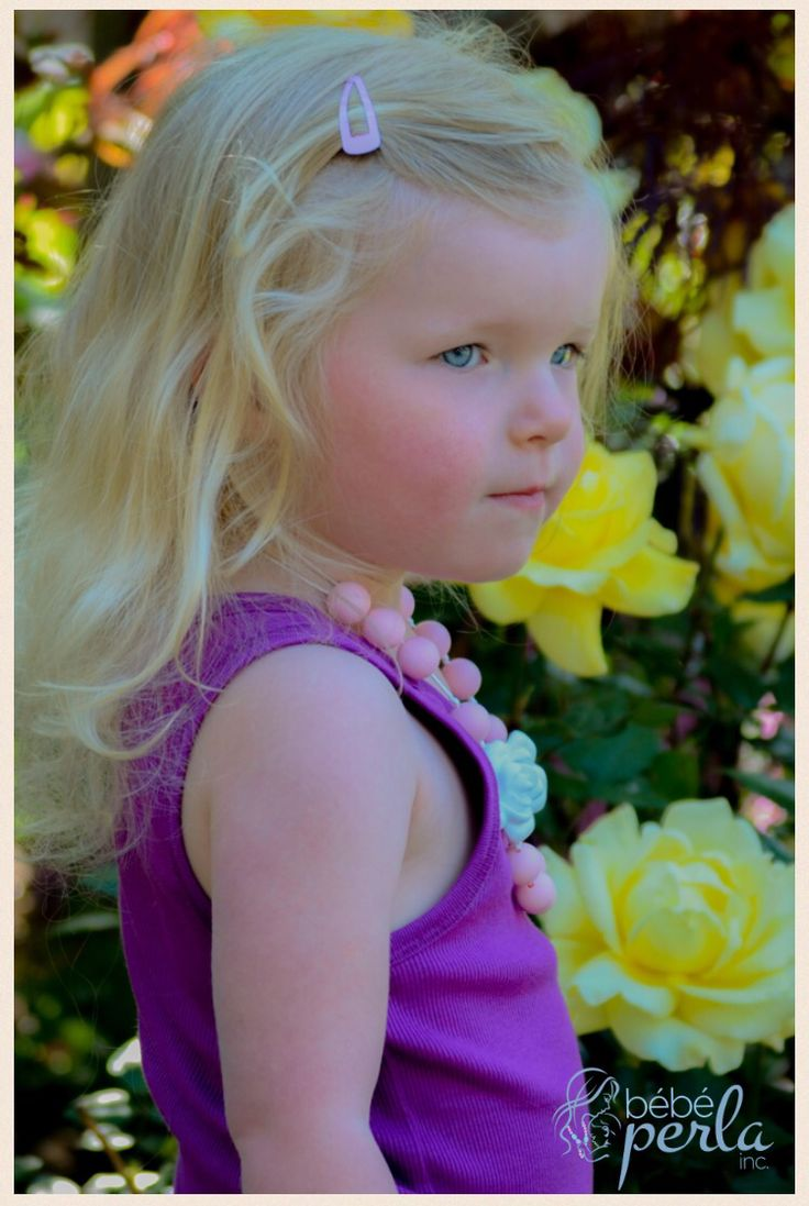 Such a little model! Here is Haley modelling our Mommy and Me necklace set in Pink Flora. www.bebeperla.com