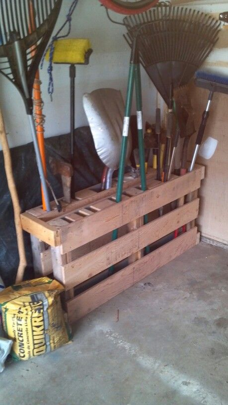 Two small pallets, scrap 2x4's and here you have a garden tool rack.