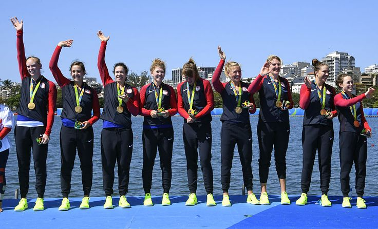 Gold medallists USA's Katelin Snyder, USA's Kerry Simmonds, USA's Emily Regan, USA's Amanda Polk, USA's Eleanor Logan, USA's Lauren Schmetterling, USA's Amanda Elmore, USA's Meghan Musnicki and USA's Tessa Gobbo celebrate on the podium of the Women's Eight final rowing competition at the Lagoa stadium during the Rio 2016 Olympic Games in Rio de Janeiro on August 13, 2016. / AFP / Damien MEYER