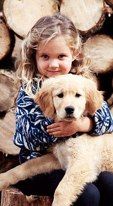 Golden retriever puppy and toddler