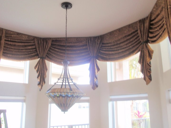 custom window treatment with ties is interesting and decorative