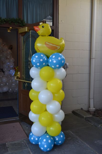 Ducky Duck Baby Shower Ideas.  Add a copy of Ducklings in a Row for the new baby's library!