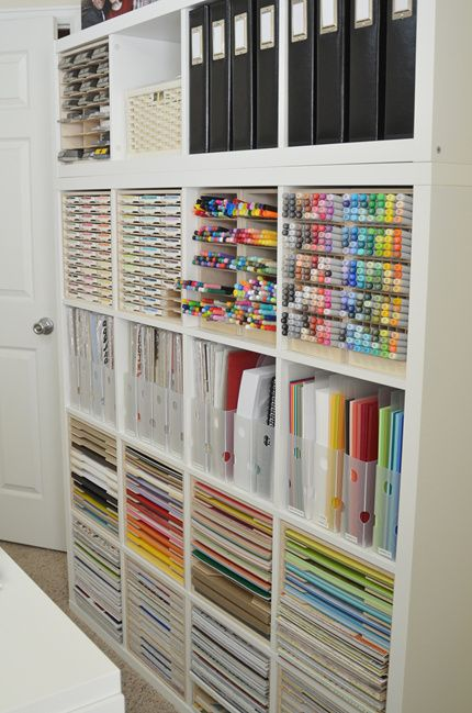 beautifully organized craft room with IKEA shelving and Stamp-n-Storage cabinets that are designed just for the Kallax. You should see her papers, ink pads, punches and markers! http://www.stampnstorage.com/blog/october-studio-showcase-winner/