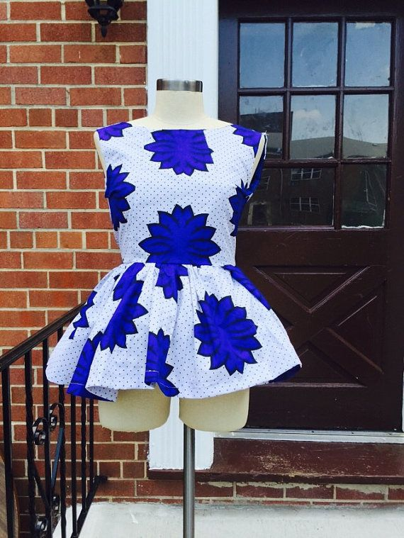 Ankara blue and white print peplum top. Can be worn with pencil skirt, jeans,, or how ever you will like to wear it. Zipper closure in back easy to put on