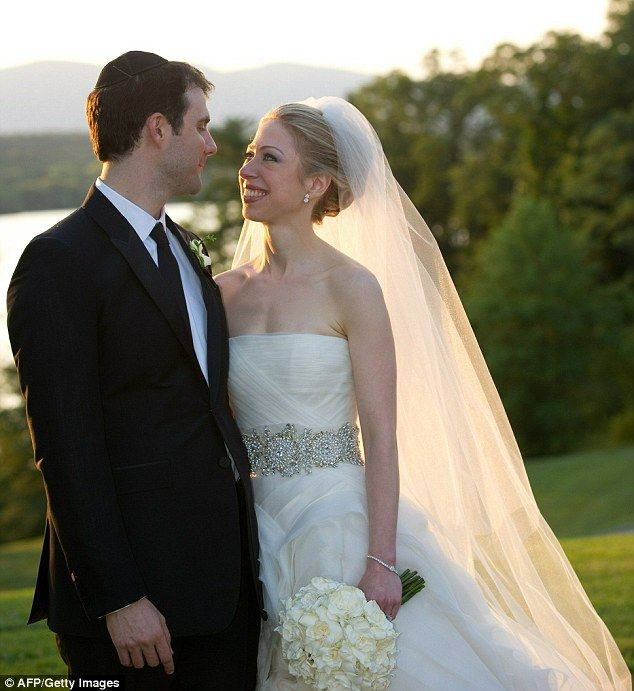 Chelsea Clinton Wedding - Idyllic setting: Chelsea and new husband Marc pose for photographs after getting married at Astor Courts, in New York state