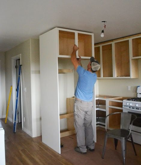 built in fridge with plywood sides + wall cabinet