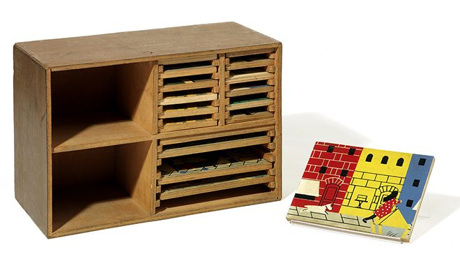 This delightful miniature timber games chest, designed by Ernö Goldfinger was a mock up for furniture displayed in 'The Child' exhibit in Oliver Hill's British Pavilion at the 1937 Paris Exhibition.