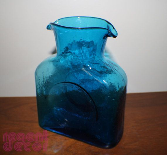 Another staple for every mid-century collector, a Blenko water bottle. This one is a beautiful turquoise color. In excellent vintage condition with