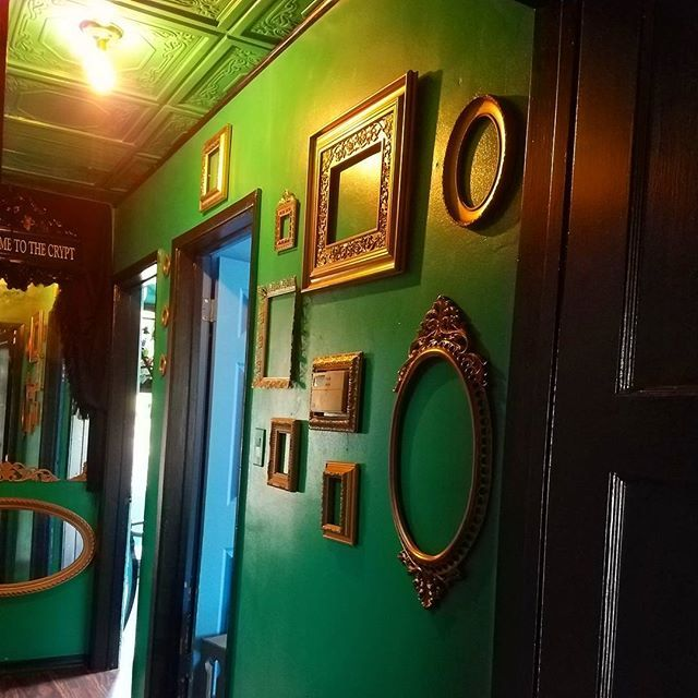 Crypt of memories. Empty frames are my newest thing. And a frame around the thermostat helps to hide the hideous thing  #gothicdecor #blackmanor #ilovemyhouse #everydayishalloween #gothicdecorating #gothicmarthastewart #gothdecor #hallway #greenwall #gold #diydecor
