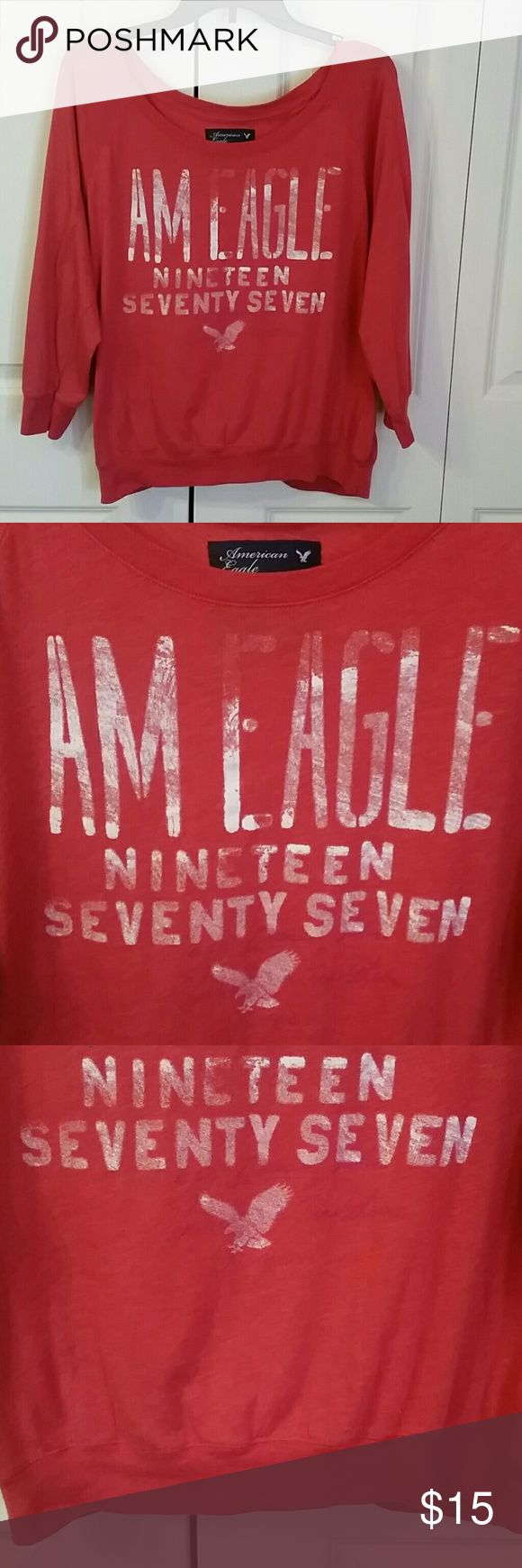 SUPER COMFY TOP! Really nice 3/ 4 sleeves,  banded bottom , lightweight tshirt excellent condition distressed look is intended American Eagle Outfitters Tops