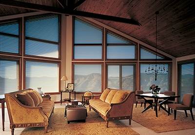 Transform the beauty of this open living space by controlling and softening the harsh light from outside with Silhouette® window shadings ♦ Hunter Douglas window treatments #LivingRoom