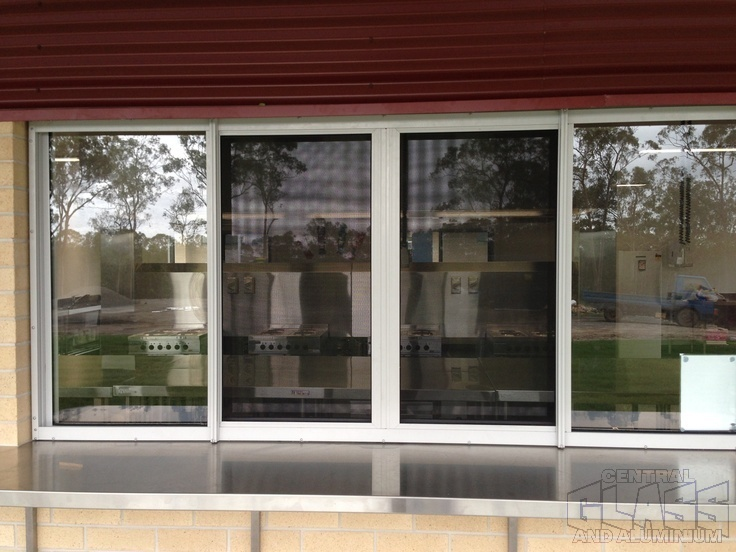 Crimsafe sliding Safe S Cape window at LORDS (Lutheran Ormeau Rivers District School) Pimpama; great servery idea - part of our installation of windows 2012