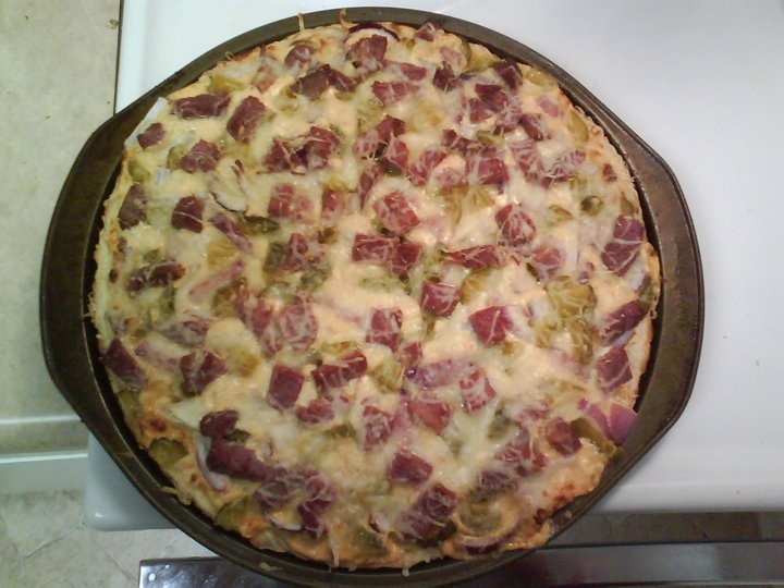 Reuben Pizza: corned beef, red onion, pickles, Swiss cheese, thousand island dressing