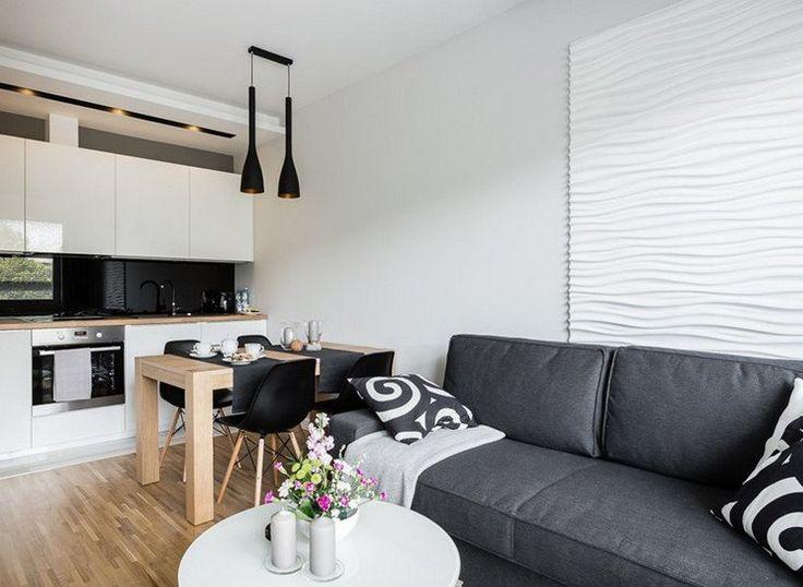 canapé gris anthracite droit 2 places dans le salon ouvert sur la cuisine avec coin-repas