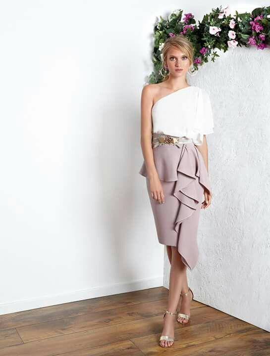One shoulder blouse, ruffled skirt.