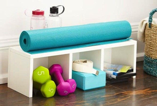 Use storage bins or a cabinet with multiple nooks to keep all your fitness gear organized.