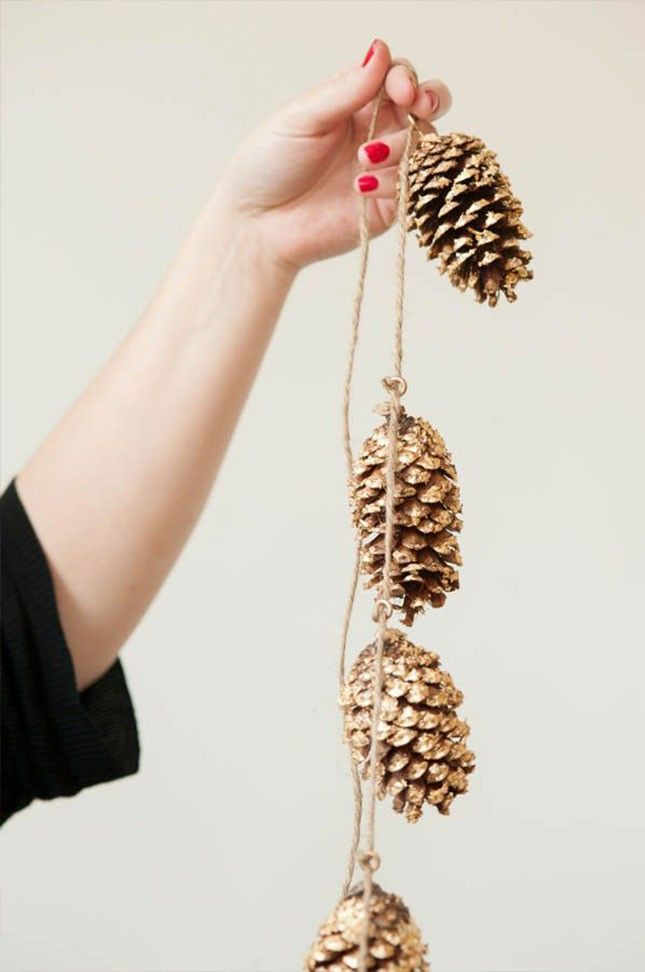 Spray paint pinecones gold to make this holiday-ready garland.