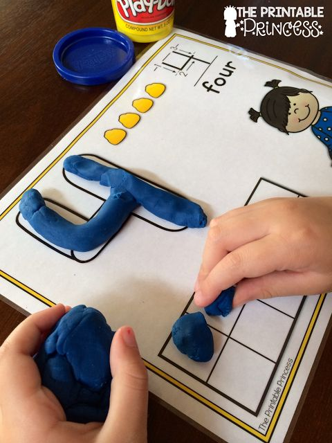 Using play dough mats to teach numbers and build fine motor skills. She's got lots of ideas for fine motor practice on this post.