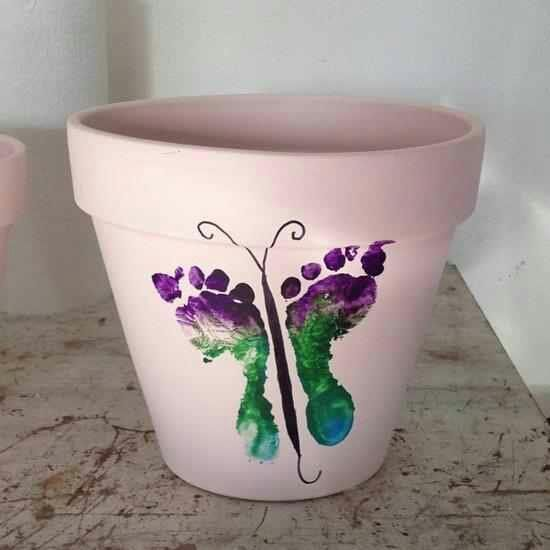 This would be a great mother's day gift for grandma! A butterfly made out of footprints for a planter. What a great gift!