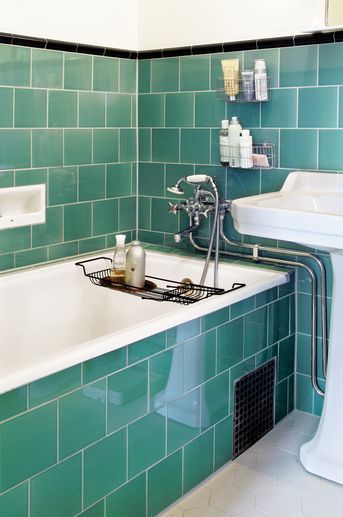 """1930's"" green tile bath with hexagonal ceramic floor tiles."