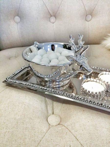 Nydelig sølvskål i porselen med reinsdyrhode. 16x12x11cm