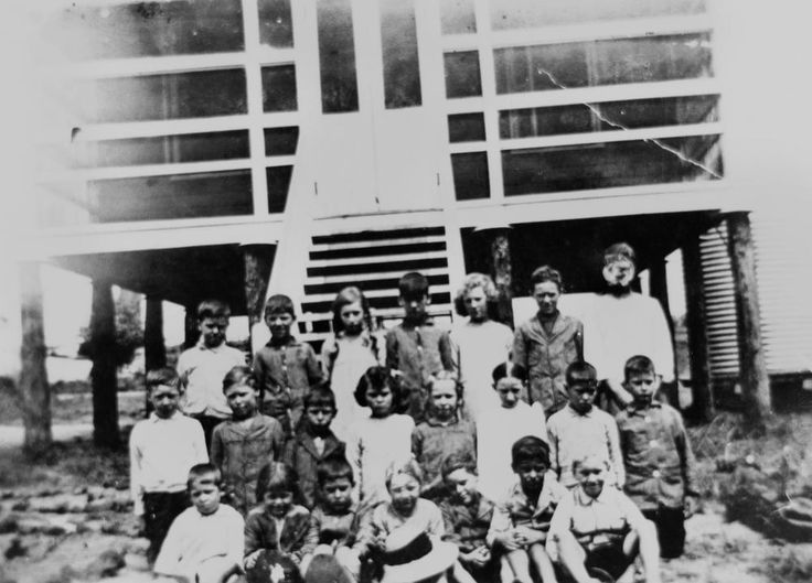 Children of Russell Island School, Russell Island, Brisbane, Queensland, ca. 1919 - A group of school children posed in front of the school building on Russell Island, Moreton Bay, Queensland, ca. 1919.