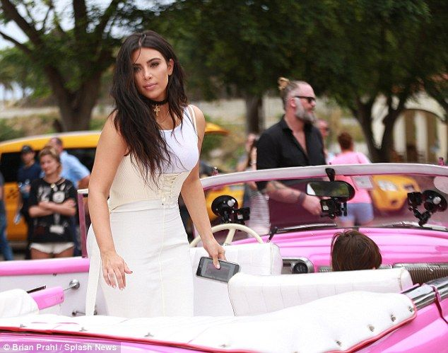 All aboard! Once the reality star ensured her hair and makeup were perfect she hopped into the vintage vehicle