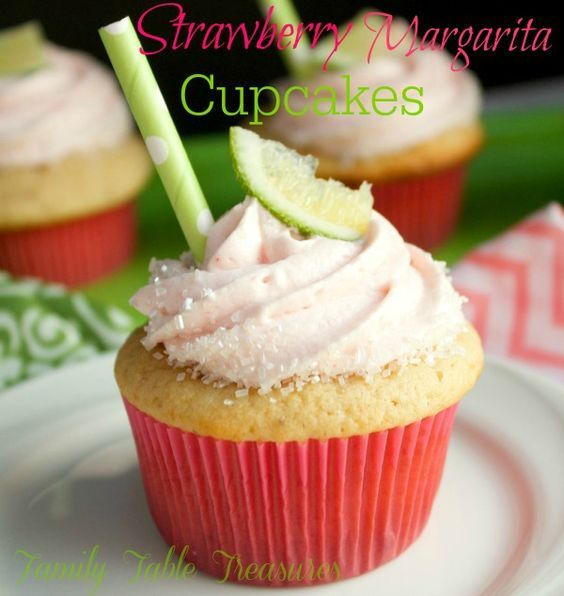 Strawberry Margarita Cupcakes - Family Table Treasures                                                        Fresh strawberry cupcakes soaked with a lime, tequila simple syrup and then topped with a fresh strawberry and tequila cream cheese frosting.  These Strawberry Margarita Cupcakes are the perfect treat for your next adult summer fiesta!