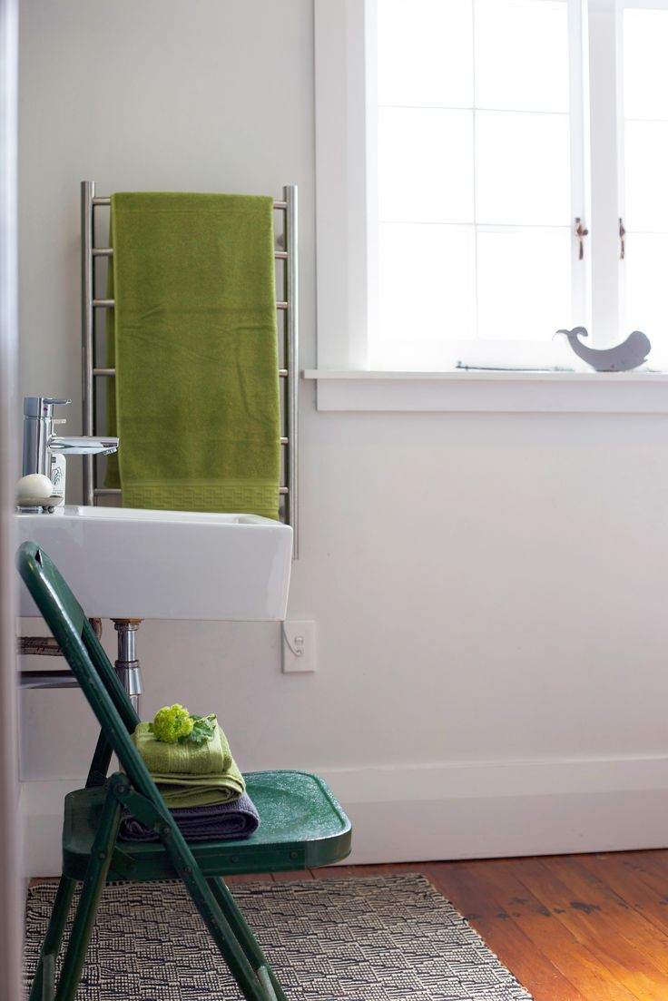 #Green vintage chair. #Green bath towels. #Spring bathroom. Staging by Places and Graces.