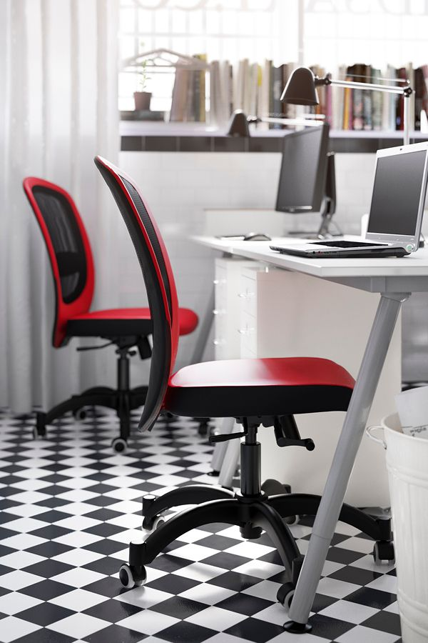 a small office with white desks drawer units shelf units and swivel chairs in red ikea