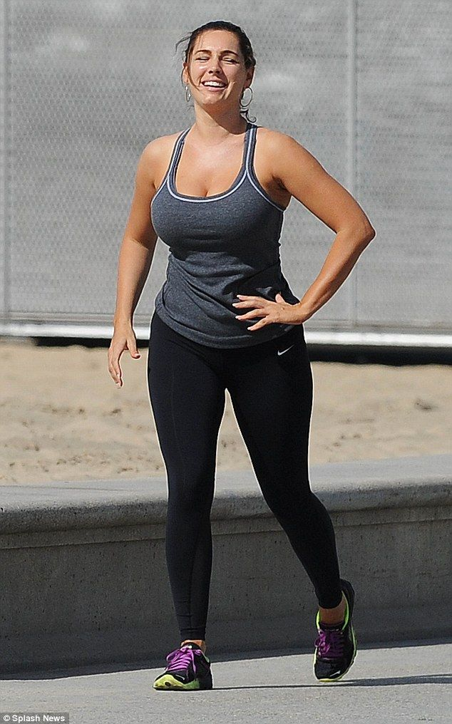 Kelly Brook almost spills out of low-cut work out vest on the beach   Daily Mail Online