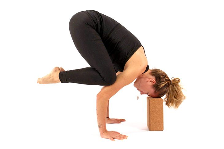 Supported Bakasana – Supported Crane Pose. Blocks are wonderful props to get in the habit of using with many arm balances because most students aren't aware of just how far forward you need to go to find the balance.