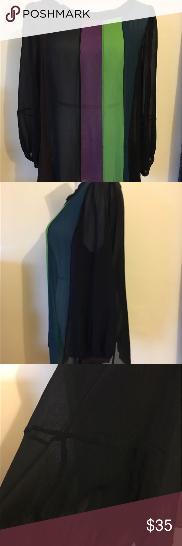 "DKNY Sheer Silk Striped Overized 👚 w/ Pockets Totally sheer with beautiful colors. Black navy purple green teal. Puckered shoulders. Two hip pockets. Looks good Oversized on a size Small or true to size. Very flowy. 40"" bust 17"" shoulders 20.5"" sleeves 27"" back of neck to hem DKNY Tops Blouses"