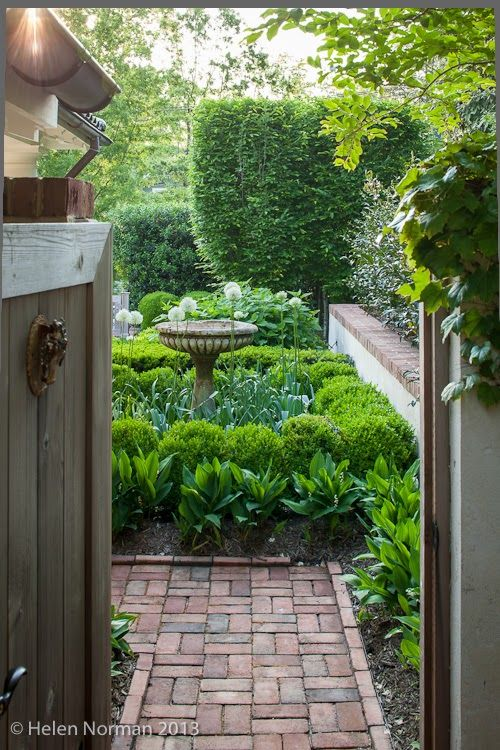 brick path with a glimpse of what lies around the corner - Modern Country Style: Modern Country Garden Tour