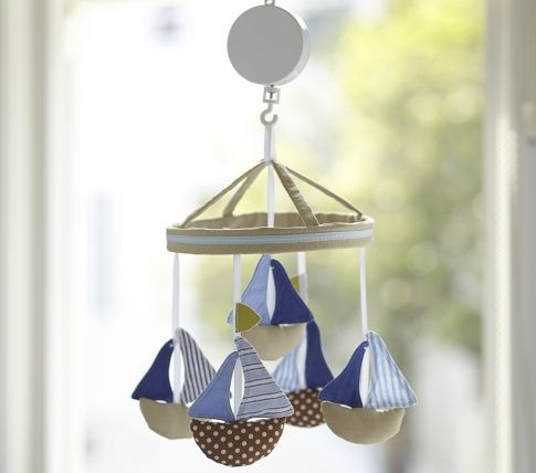 @Jamie Wise Schechter... this is from PB and of course is WAY overpriced so I think we should buy a cheap mobile, take it apart and make our own with cute little boats!!! This could totally be for a project after he born, while Im visiting, and your sleeping hahaha