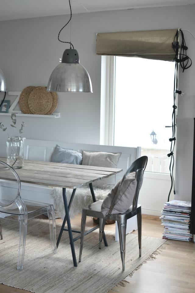 silver pendant and wood dining table