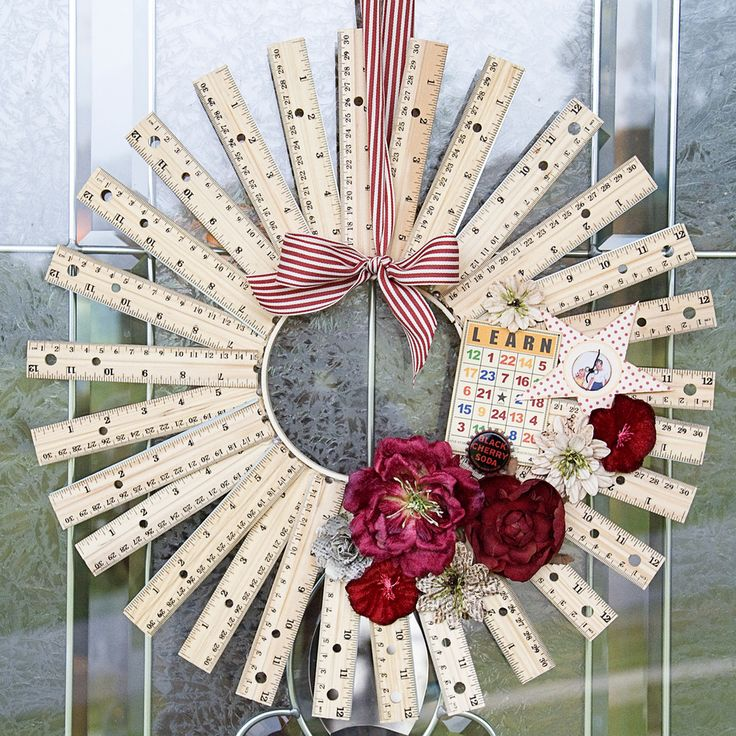 A wreath made out of rulers cut in half...hot glues to an embroidery hoop...add flowers, ribbon, etc. With  all the back to school sales going on right now what a cute gift for a classroom or your front door!