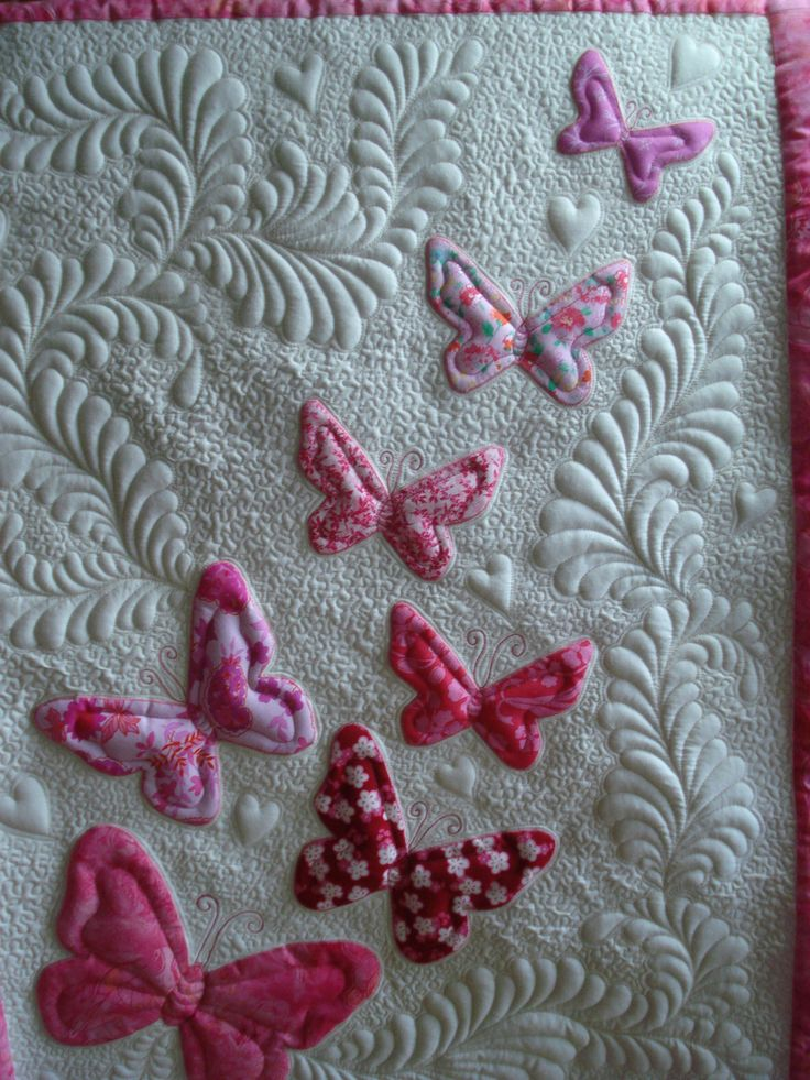 Machine appliqued butterfly baby quilt