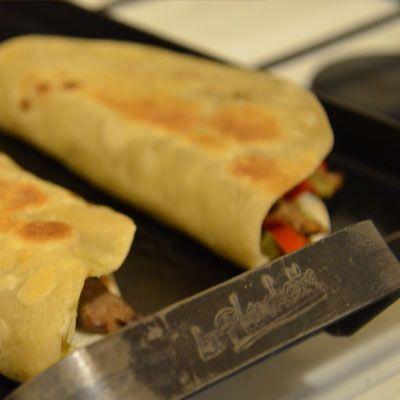 Tacos de carne de ternera en la planchetta