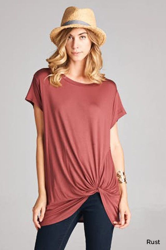 Our Tasha Top features a loose fit, round neck, short sleeve with twist detail in front. The Trisha Top is made with a soft knit fabric that drapes nicely on the body. Fabric 95% Modal, 5% Spandex Mad