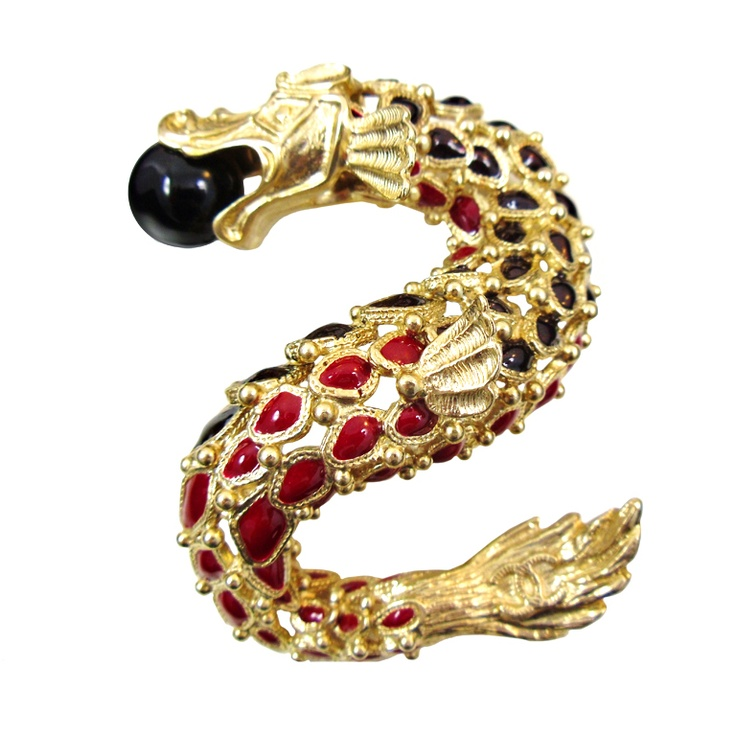 An enamel and glass dragon brooch from Chanel's 2010 ...